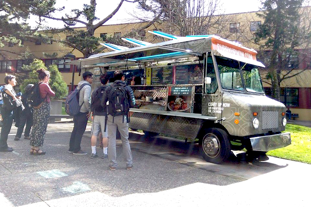 food truck vendor serving lunch to students